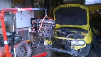 2016 032901 Spare engine out of yellow car